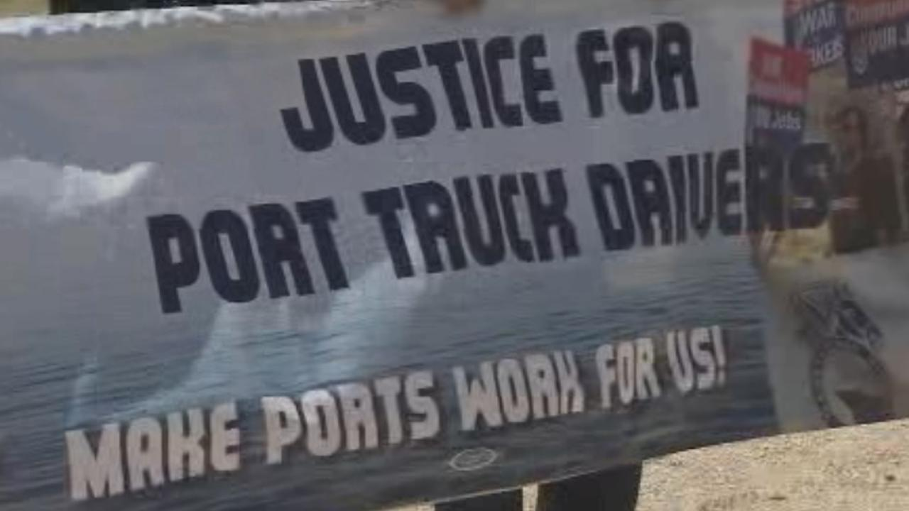 A sign that reads, Justice for port truck drivers. Make ports work for us! is seen in this photo from July 2014.