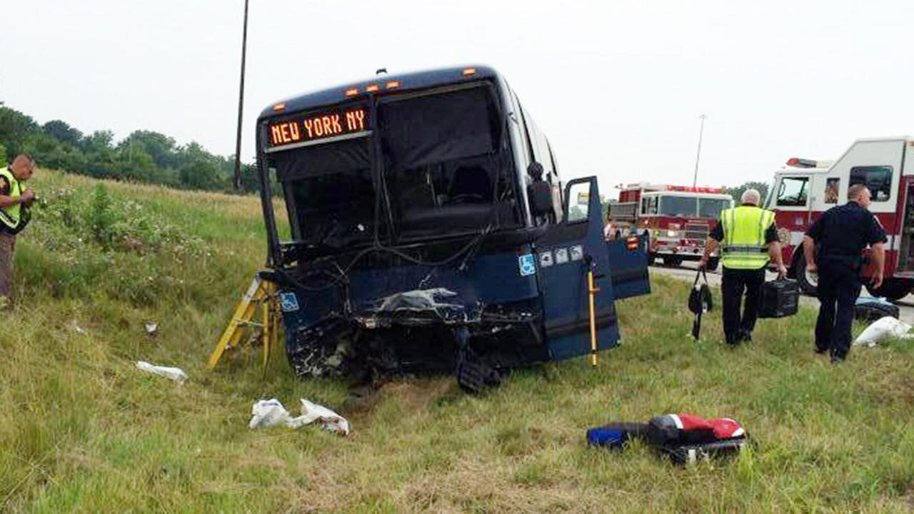 Emergency personnel respond to the scene of a bus accident on Sunday, July 13, 2014 on interstate 70 near Richmond, Ind.