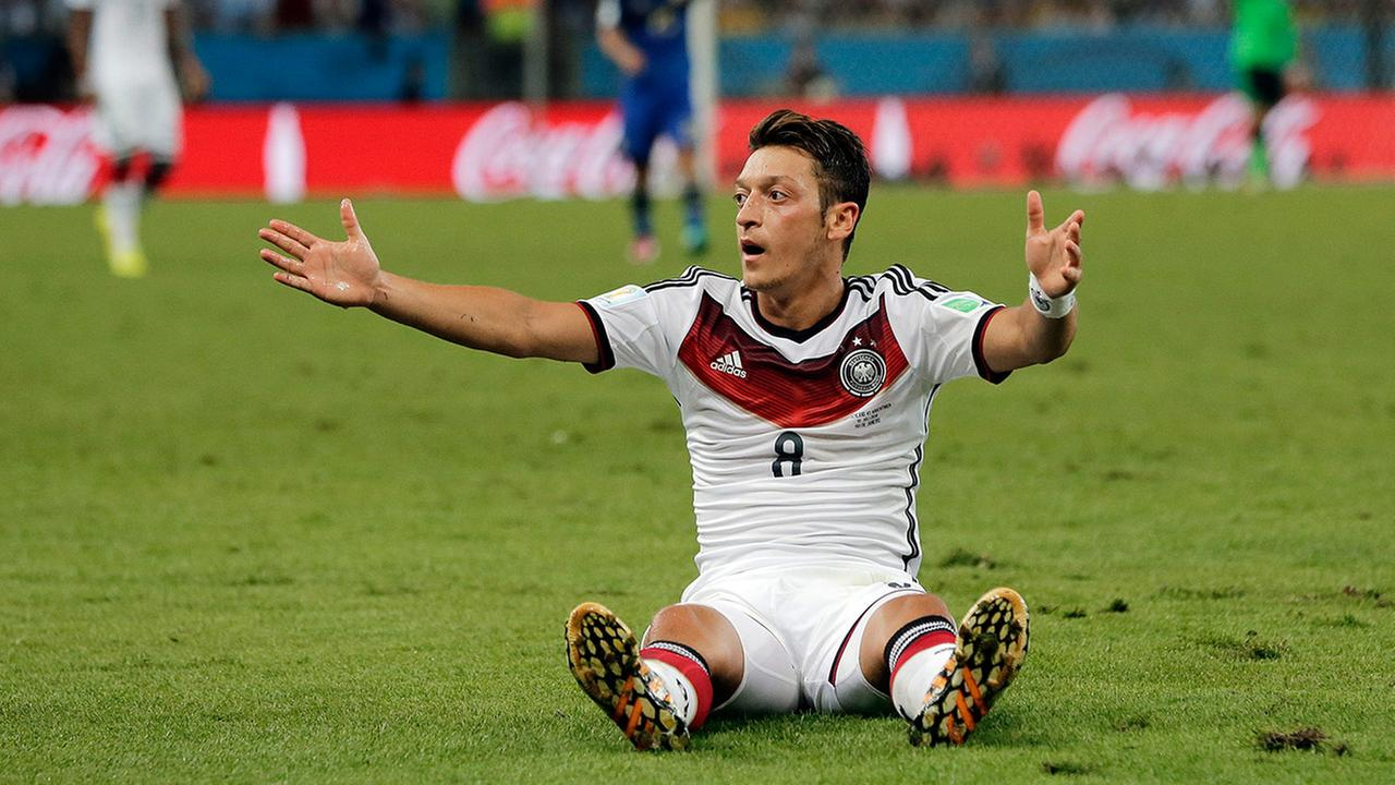 Germanys Mesut Ozil gestures for an officials call after a fall during the World Cup final soccer match between Germany and Argentina at the Maracana Stadium in Rio de Janeiro. <span class=meta>(Matthias Schrader)</span>