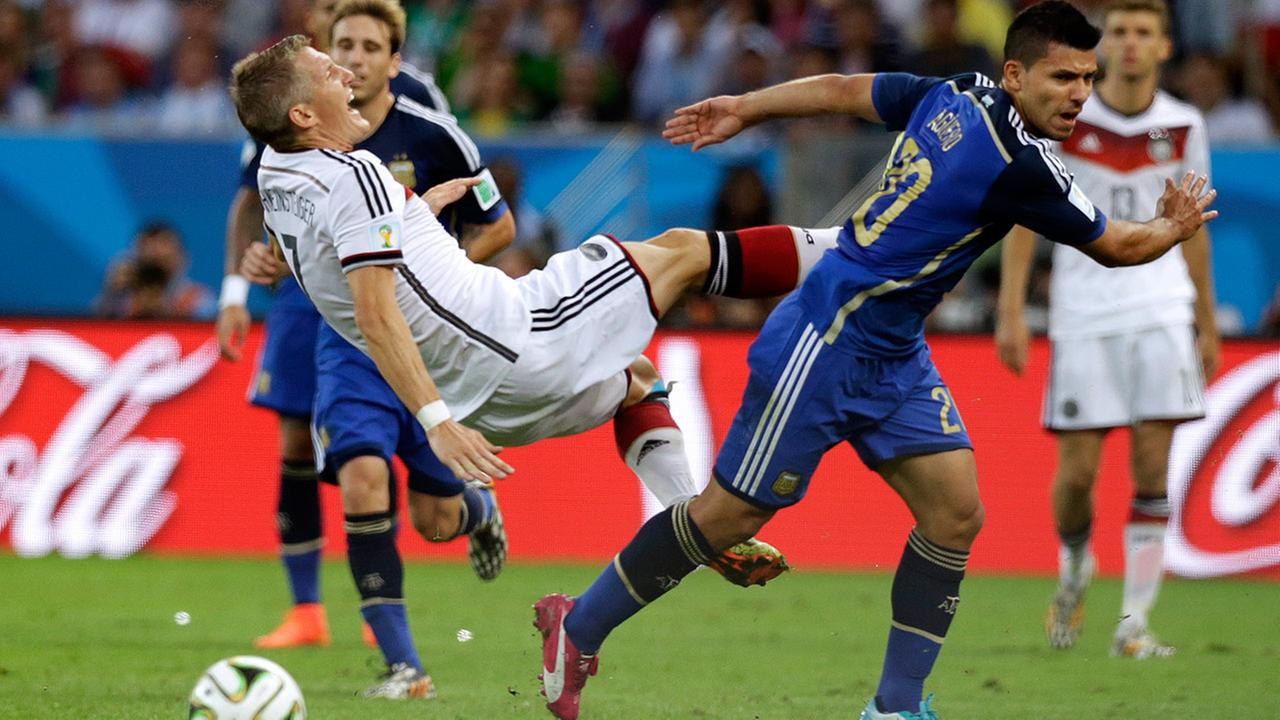 Argentinas Sergio Aguero, right, fouls Germanys Bastian Schweinsteiger during the World Cup final soccer match between Germany and Argentina. <span class=meta>(Victor R. Caivano)</span>