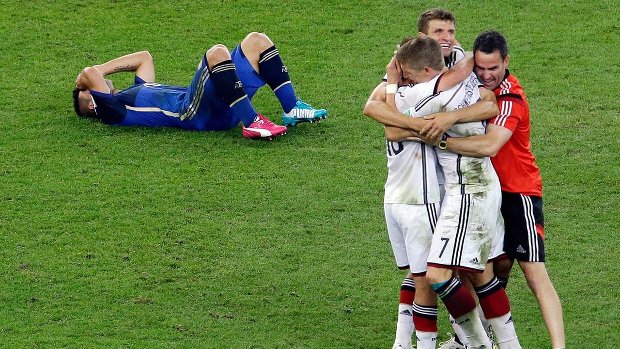 Germanys players celebrate after winning on extra time at the World Cup final soccer match between Germany and Argentina at the Maracana Stadium in Rio de Janeiro. <span class=meta>(Hassan Ammar)</span>