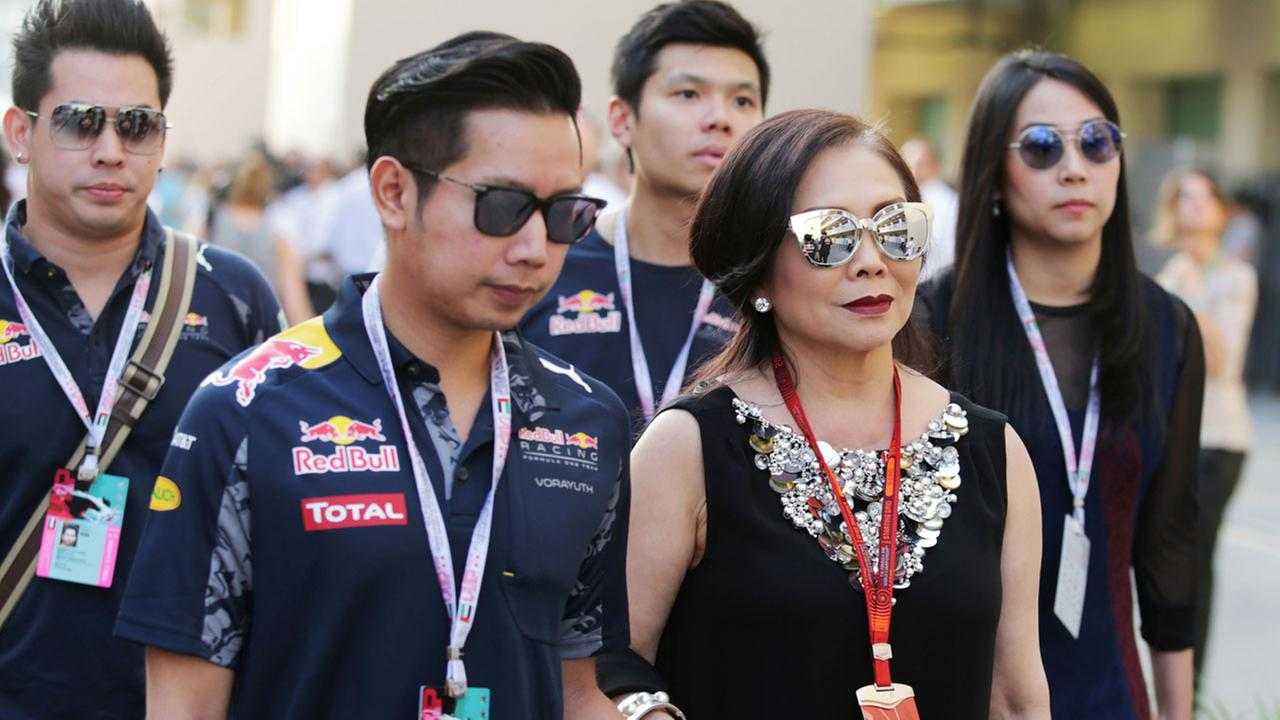 Vorayuth Boss Yoovidhya, second left, whose grandfather co-founded energy drink company Red Bull, walks with his mother in Abu Dhabi on Nov. 26, 2016.