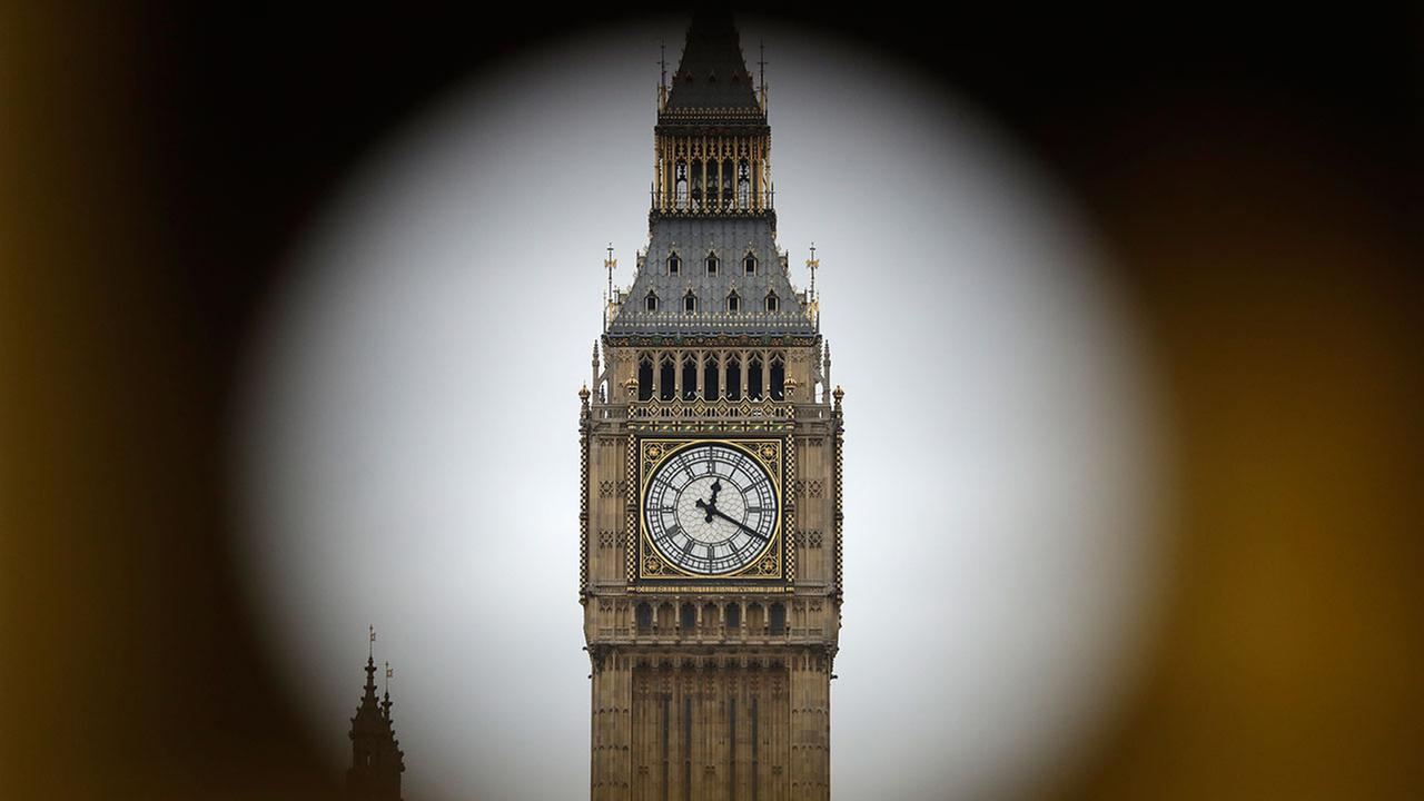 The Elizabeth Tower at Houses of Parliament containing the bell know as Big Ben are framed by a hole in central London, Wednesday, March 29, 2017.