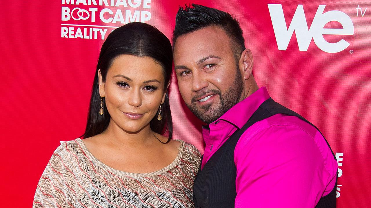Jenni JWoww Farley, left, and Roger Mathews attend WE tvs Marriage Boot Camp: Reality Stars party in New York, May 29, 2014.