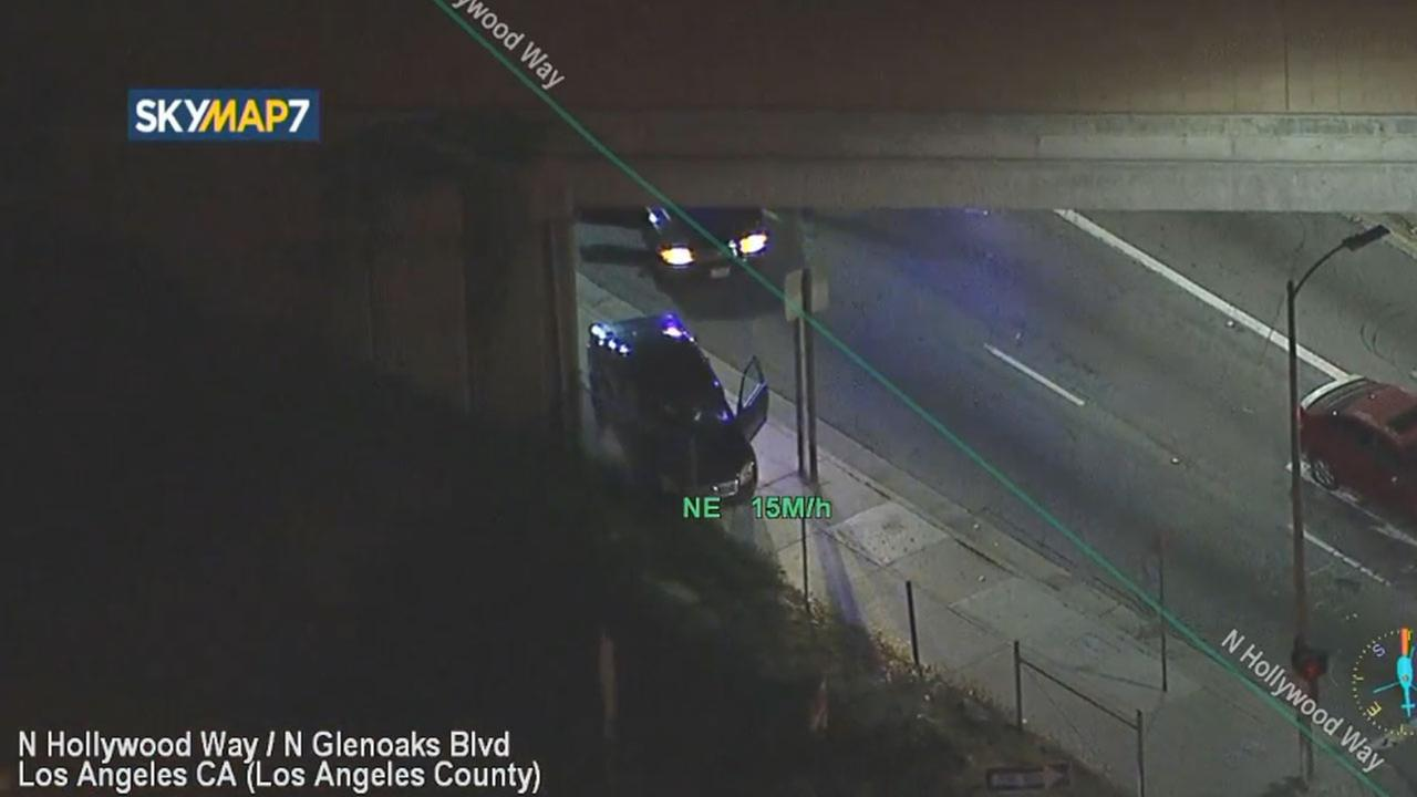 A suspect abandoned a vehicle under the 5 Freeway at Hollywood Way and fled on foot following a chase in a stolen vehicle.