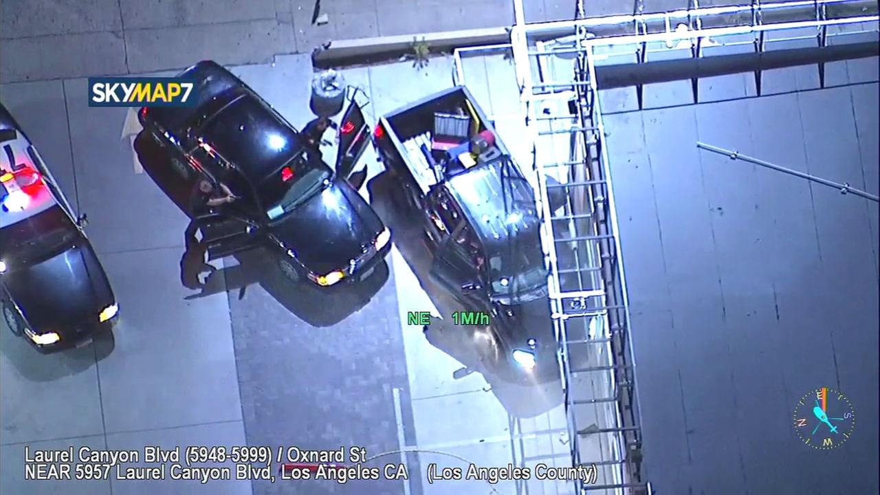 A chase of a black pickup truck ended when the suspects lost control and crashed into a pole in North Hollywood.