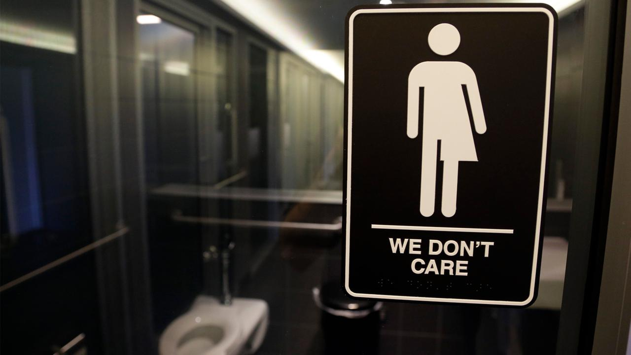 In this photo taken Thursday, May 12, 2016, signage is seen outside a restroom at 21c Museum Hotel in Durham, North Carolina.