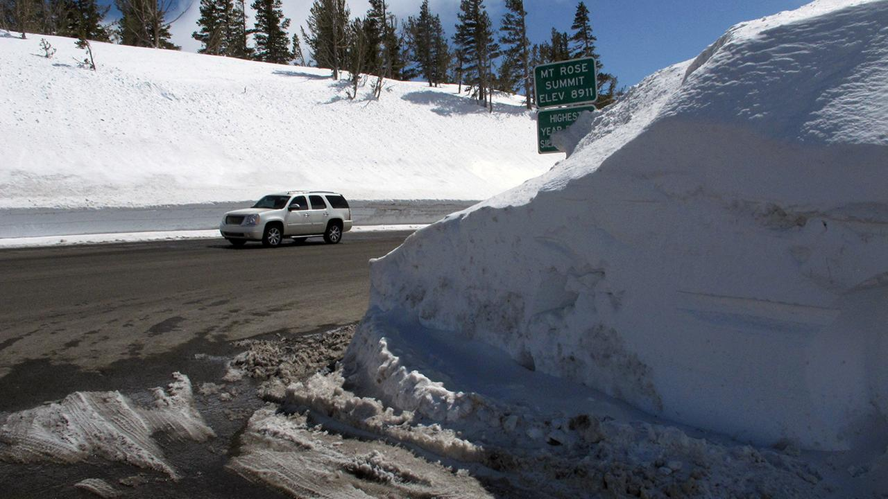 This photograph taken Sunday, March 26, 2017 shows the record snow piled at the summit of the Mount Rose Highway near the Mt. Rose ski resort half way between Reno and Lake Tahoe.