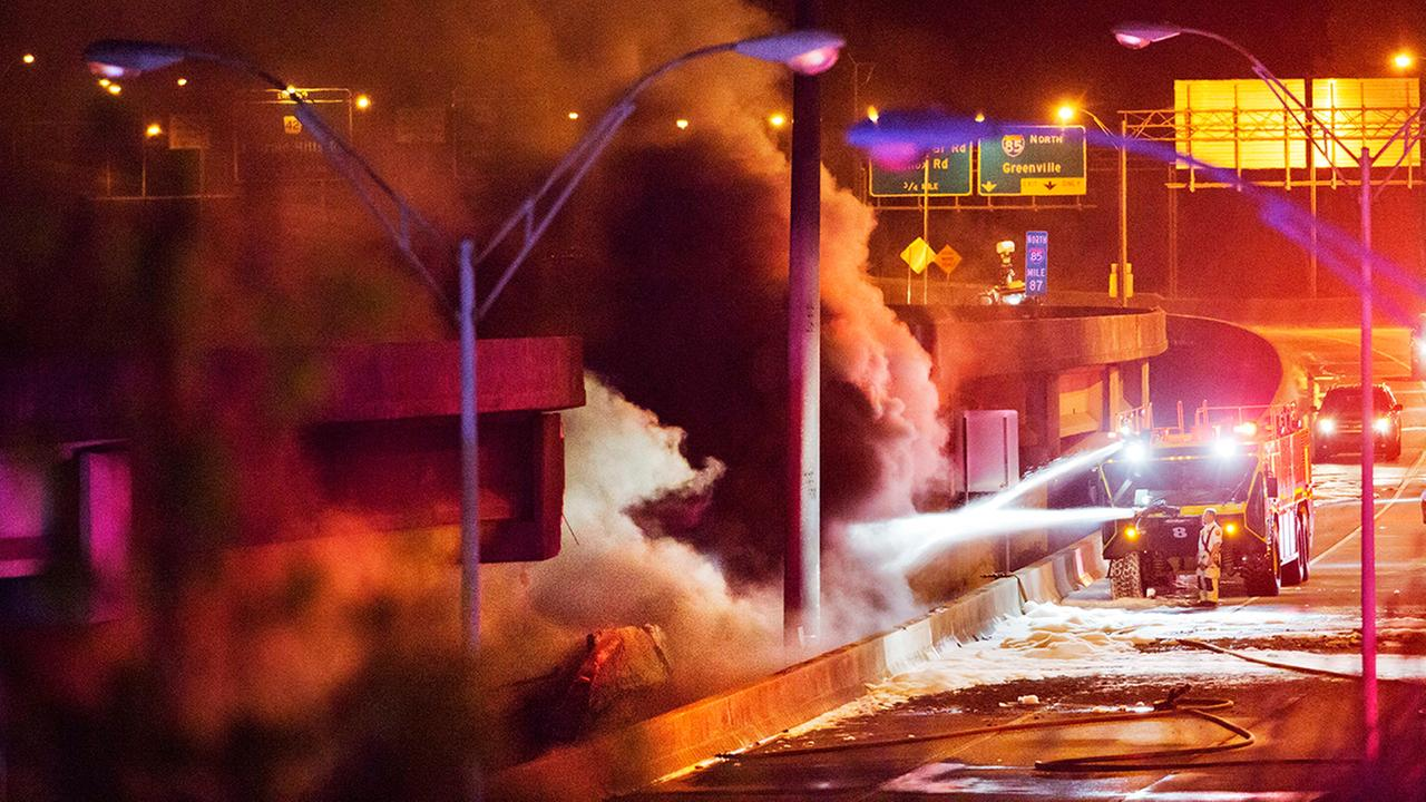 Smoke billows from a section of an overpass that collapsed from a large fire on Interstate 85 in Atlanta, Thursday, March 30, 2017.