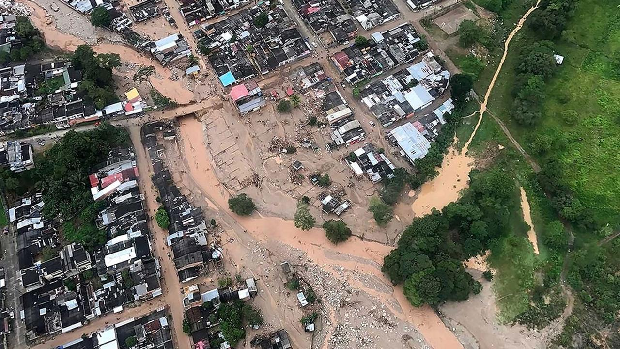 This handout photo released by the Colombia Presidential Press Office, shows an aerial view of a portion of Mocoa, Colombia, Saturday, April 1, 2017.