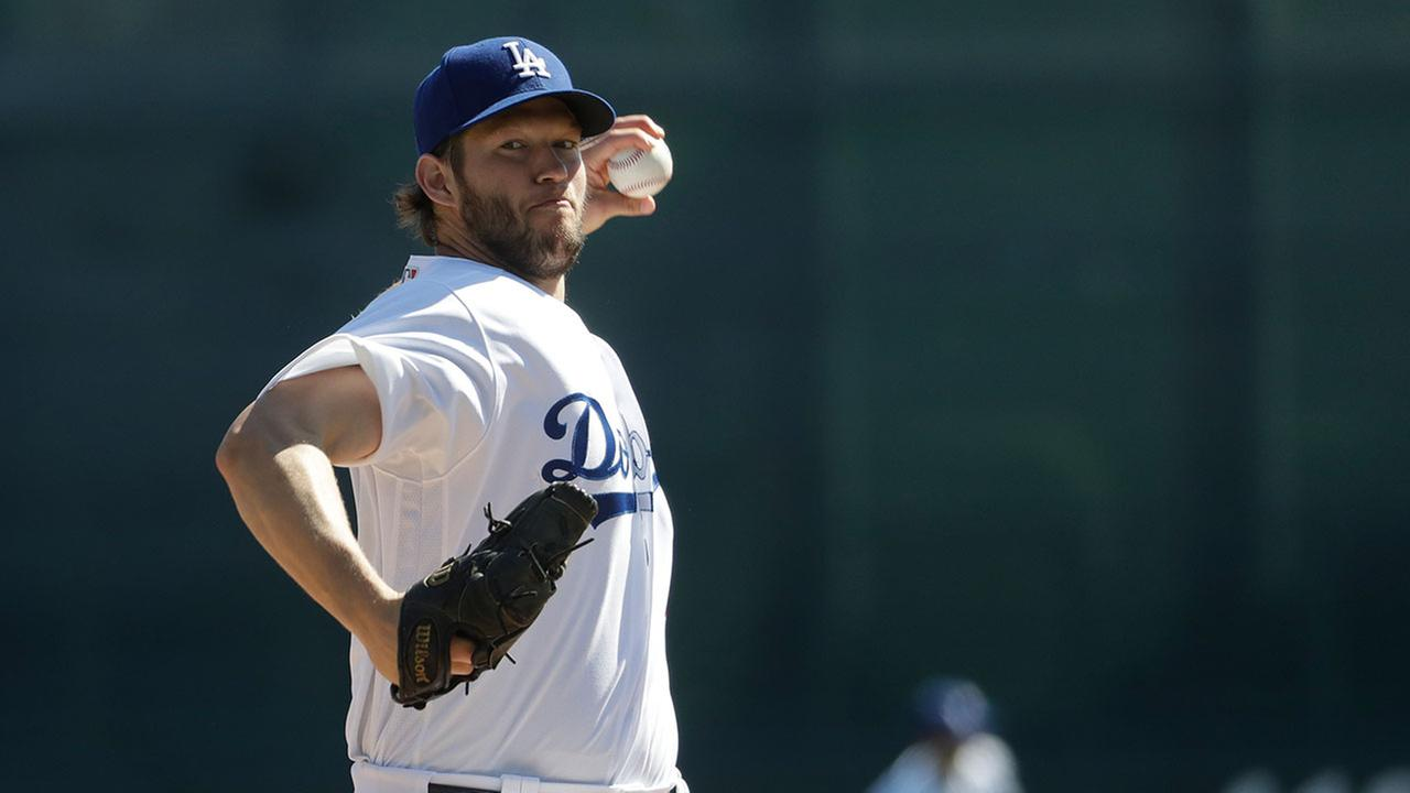 Dodgers pitcher Clayton Kershaw, pictured at a February spring-training game, is the highest-paid player in baseball this year while the team carries the leagues highest payroll.