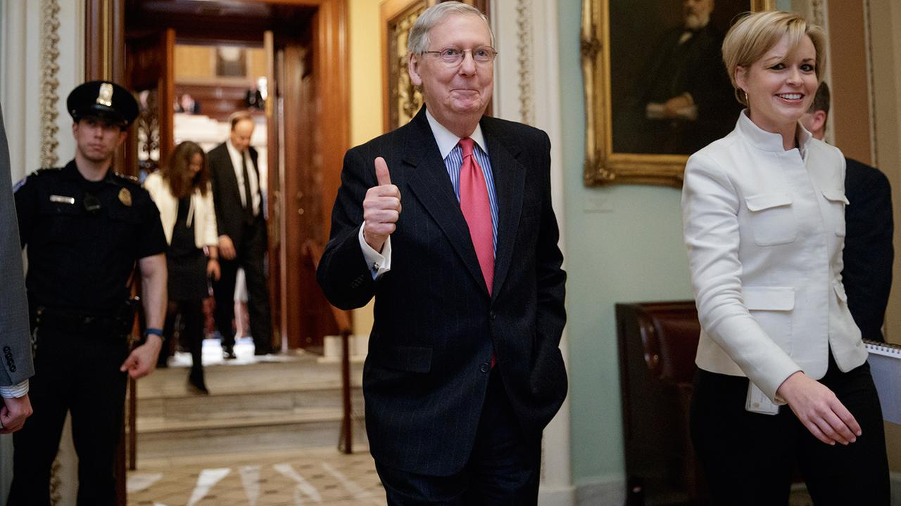 Senate Majority Leader Mitch McConnell of Ky. signals a thumbs-up as he leaves the Senate chamber on Capitol Hill in Washington, Thursday, April 6, 2017,.