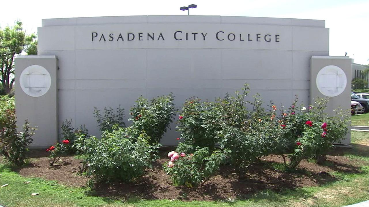 A sign for Pasadena City College is shown on the campus.