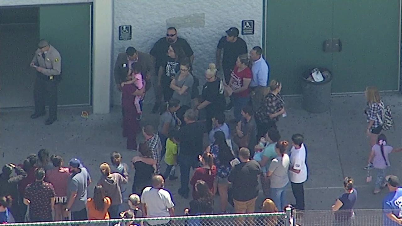 Students and parents embraced at Cajon High School as they were reunited following a shooting at North Park Elementary School in San Bernardino on Monday, April 10, 2017.