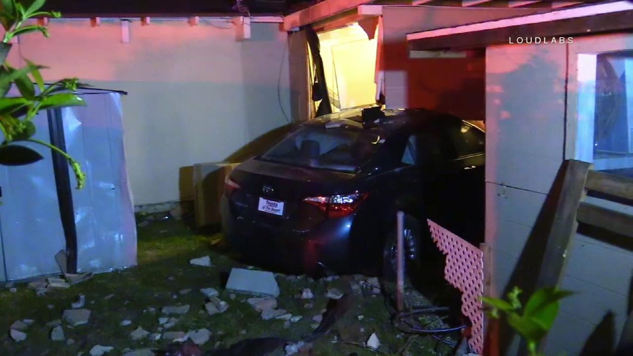 A car slammed into a home in Fountain Valley at the end of a police chase on Tuesday, April 11, 2017.