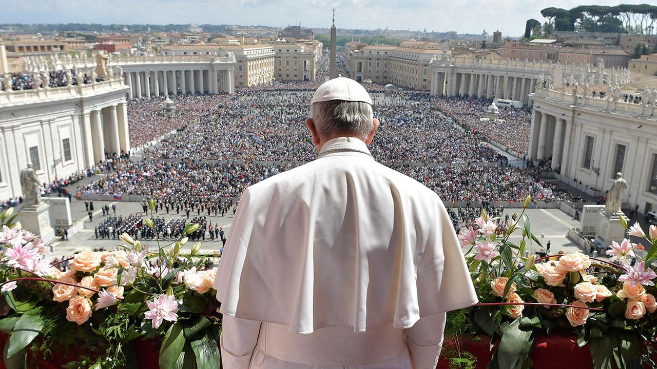 Pope Francis addresses the crowd prior to delivering his Urbi et Orbi message at the Vatican, Sunday, April 16, 2017.