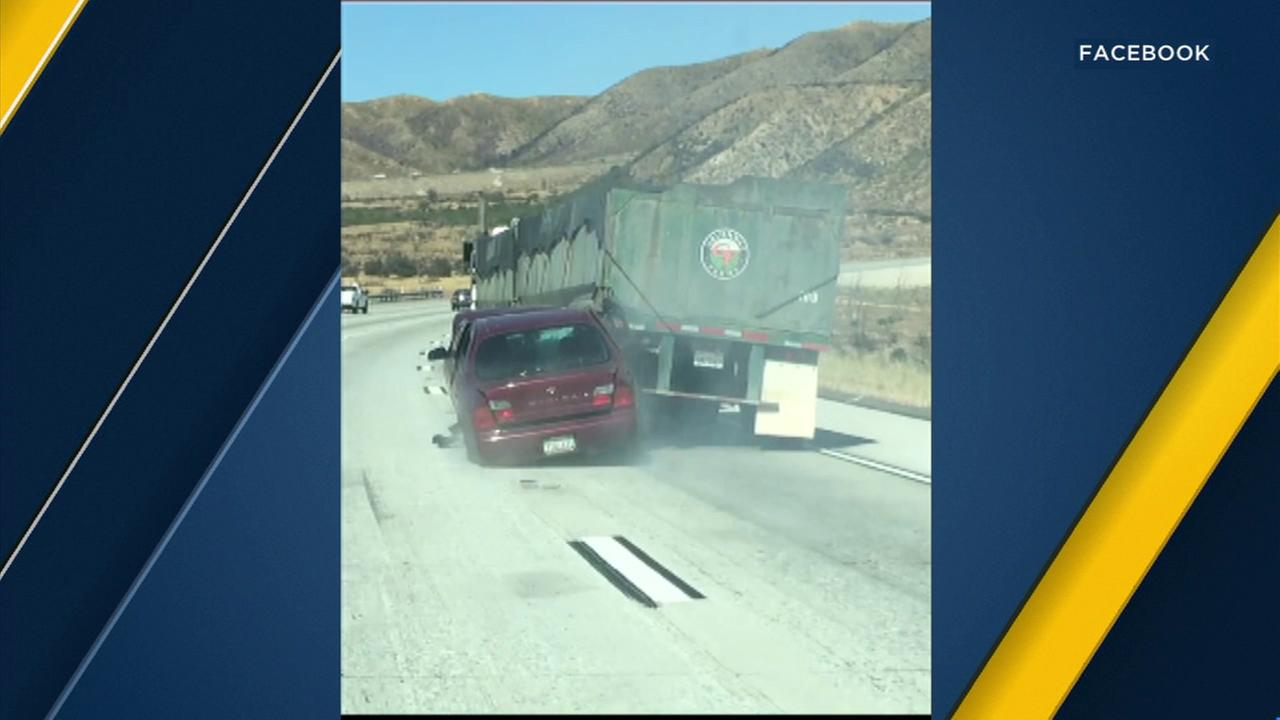 VIDEO: Car, lodged under semitruck, dragged along 15 Freeway in Cajon Pass