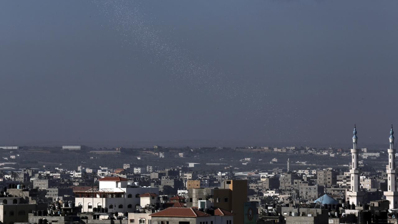 Leaflets dropped by Israeli forces plane fall to warn residents in Gaza City, Wednesday, July 16, 2014.