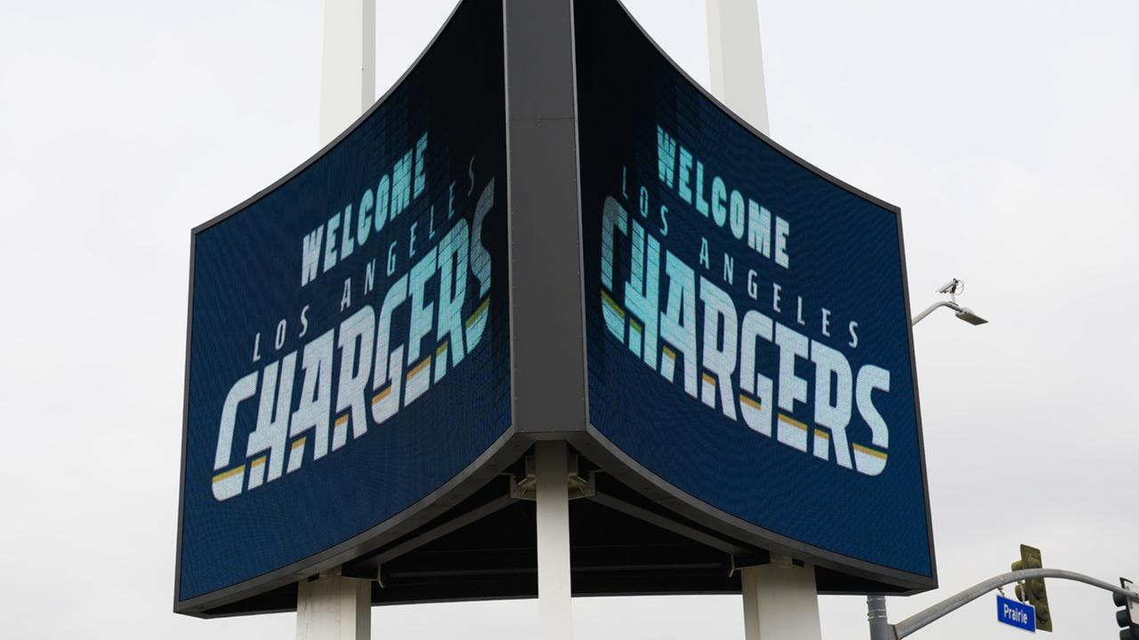 A sign is illuminated outside of The Forum to welcome the Los Angeles Chargers prior to an NFL football news conference in Inglewood, Calif., Wednesday, Jan. 18, 2017.
