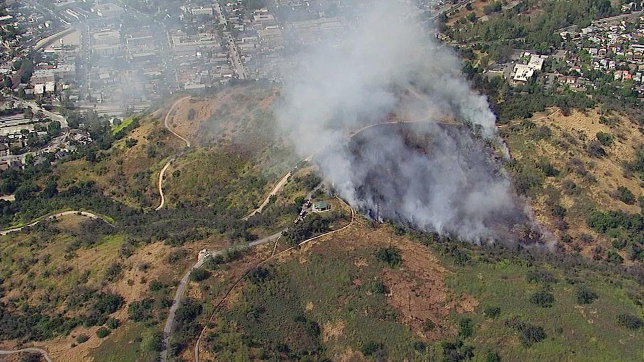 Crews battled a grass fire at Ernest E. Debs Regional Park in Montecito Heights on Wednesday, April 26, 2017.