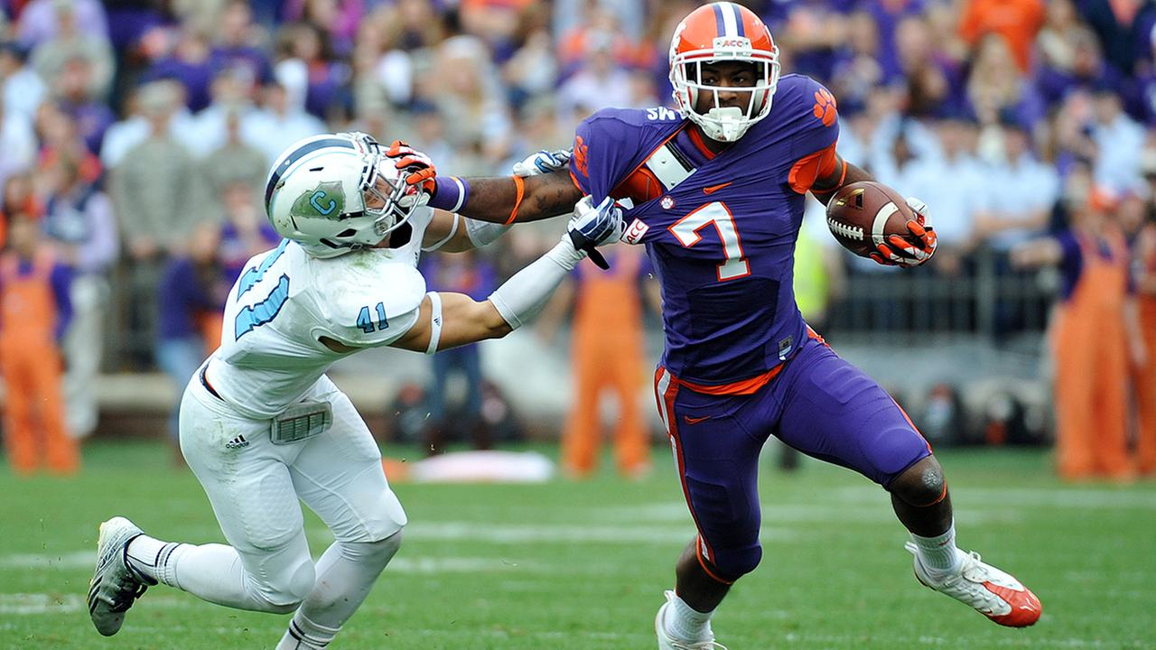 Clemson wide receiver Mike Williams runs after a catch as The Citadel defensive back Walker Smith defends during a game on Saturday, Nov. 23, 2013, in Clemson, S.C.