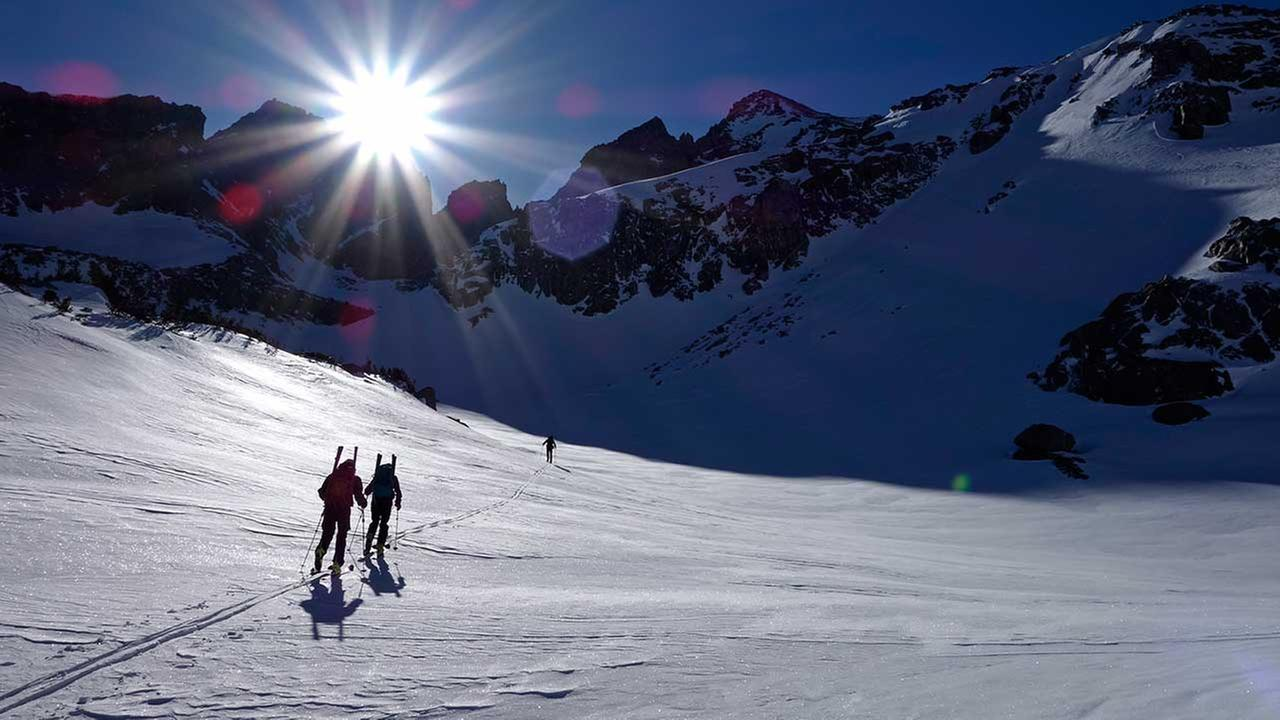In this photo taken April 1, 2017, members of a California Cooperative Snow Survey team ski toward Bishop Pass in Inyo National Forest near Bishop, California.