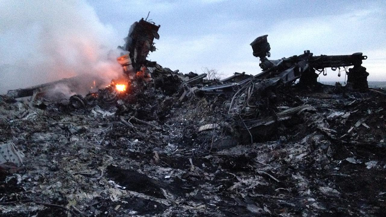 Smoke rises up at a crash site of a passenger plane, near the village of Grabovo, Ukraine, Thursday, July 17, 2014.