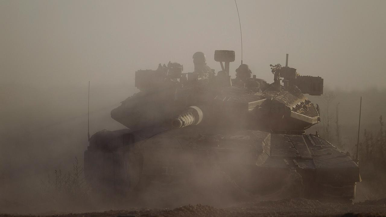 An Israeli tank takes a position along near the Israel-Gaza Border, Thursday, July 17, 2014.