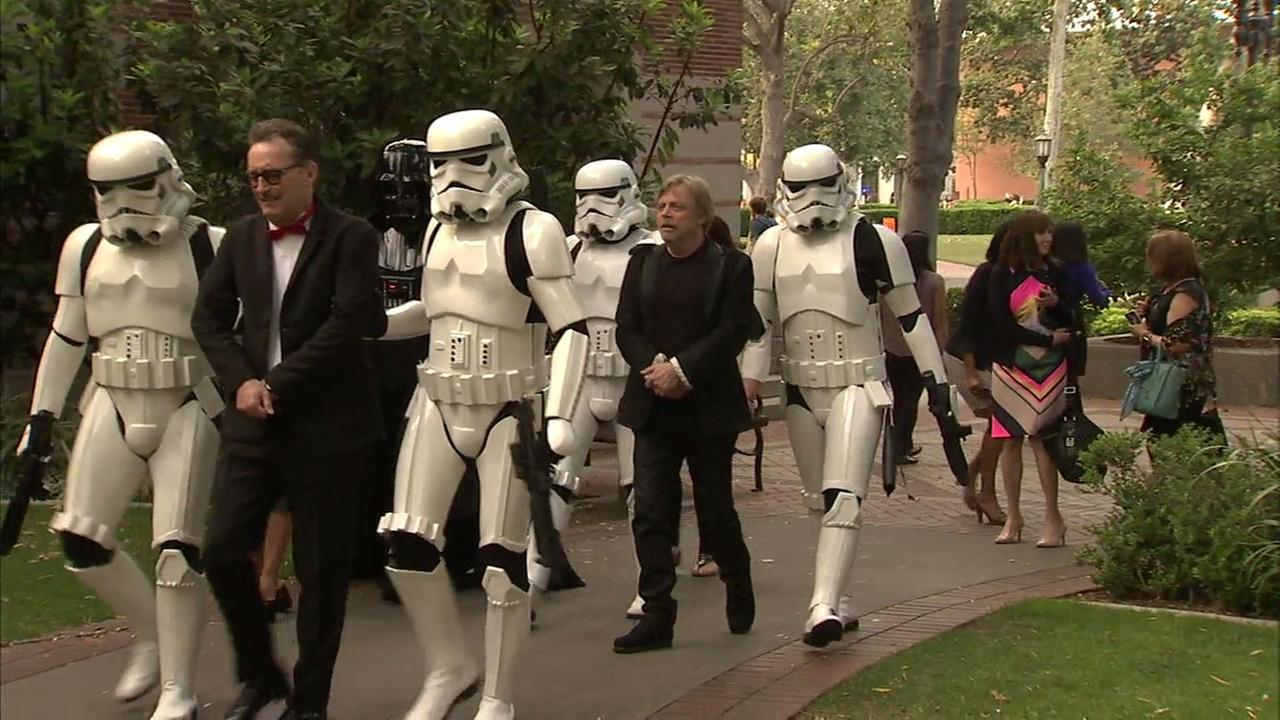 Mark Hamill arrives on USCs campus escorted by stormtroopers and Darth Vader, along with actor Tom Kenny (left), the voice of SpongeBob SquarePants.