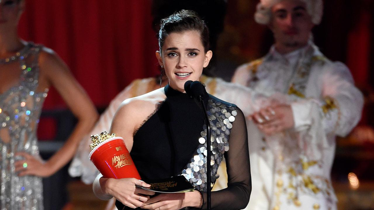 Emma Watson accepts the award for best actor in a movie for Beauty and the Beast at the MTV Movie and TV Awards at the Shrine Auditorium on Sunday, May 7, 2017.