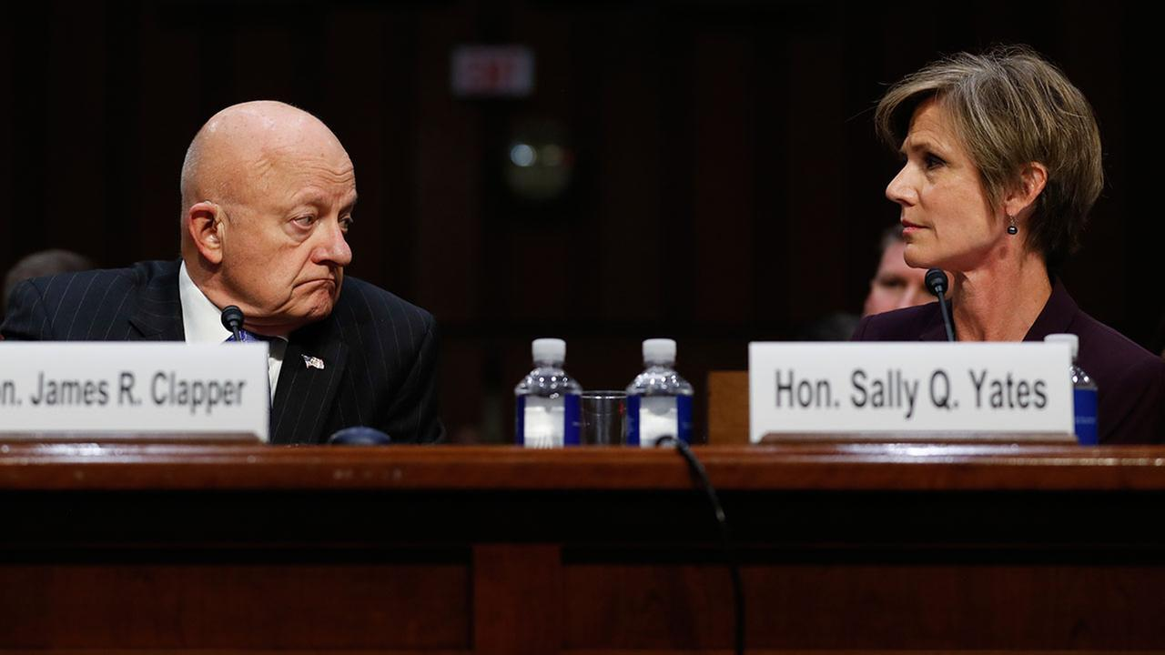 Former acting Attorney General Sally Yates and former National Intelligence Director James Clapper testify in a Senate hearing on Russian interference in the 2016 election.