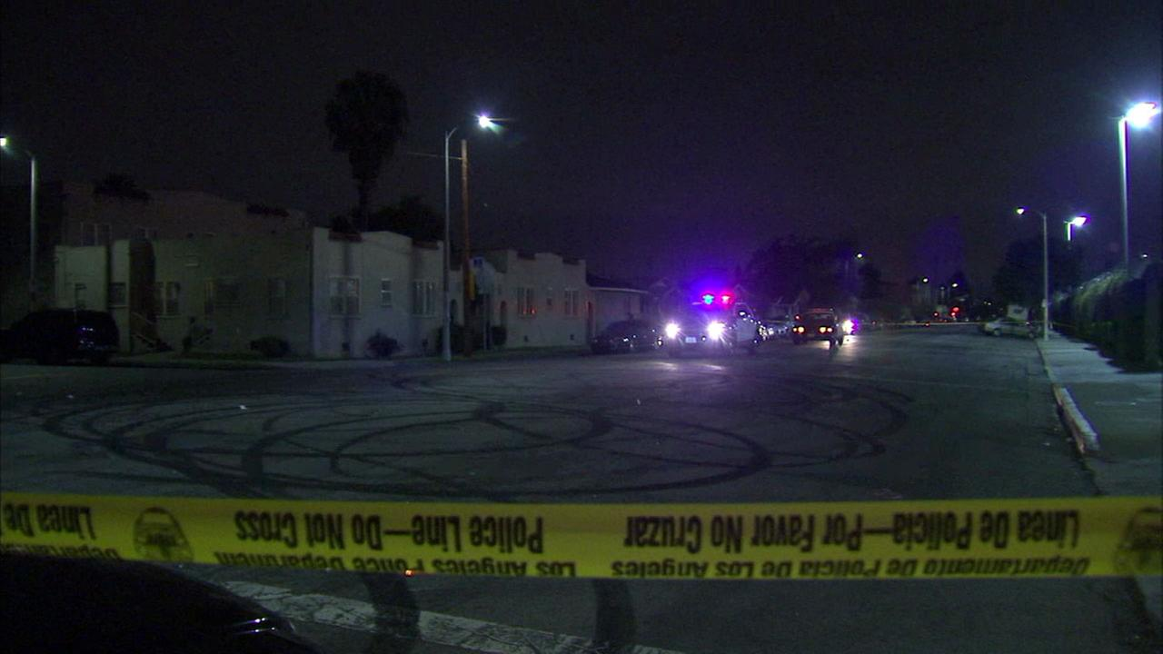Authorities cordoned off an intersection as they investigate a shooting that left an elderly man injured in South Los Angeles on Wednesday, May 10, 2017.