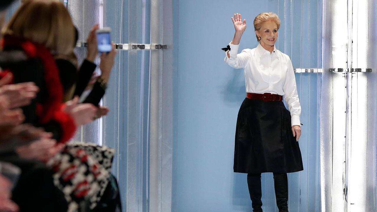 Designer Carolina Herrera acknowledges the audience after her Fall 2015 collection was modeled during Fashion Week in New York, Monday, Feb. 16, 2015.