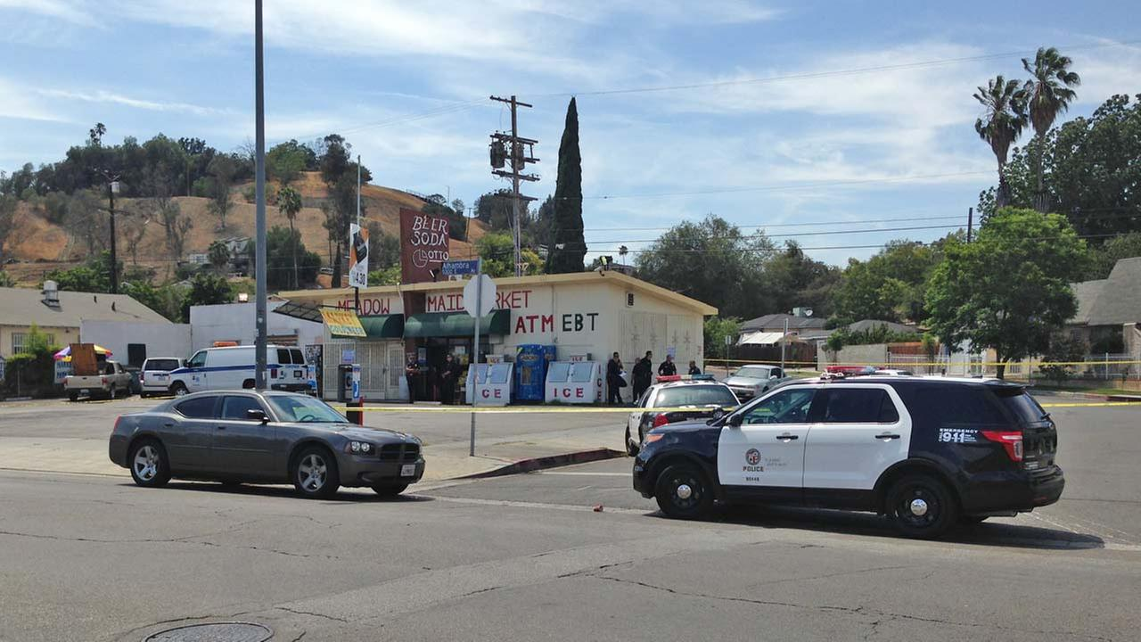 Two suspects entered the store at Alhambra and Hollister avenues at 11:15 a.m., one suspect armed with a gun and one armed with a machete, July 18, 2014.