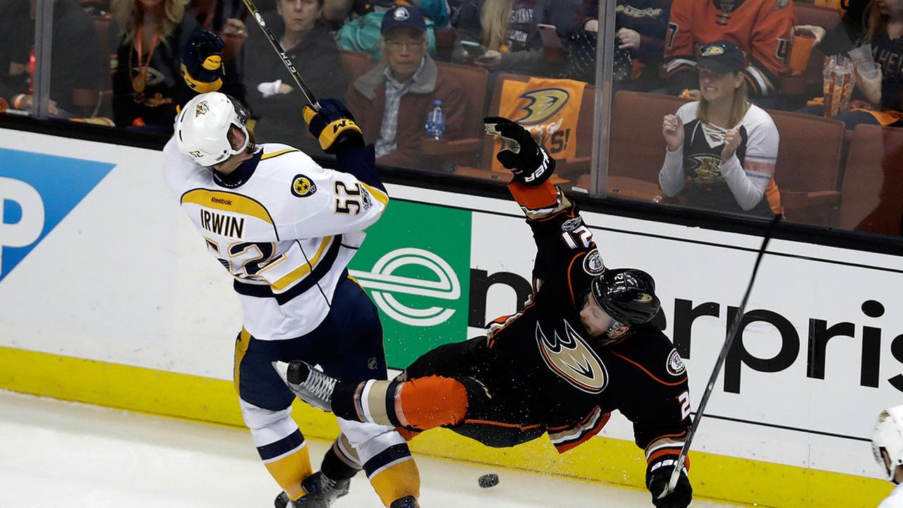 Nashville Predators Matt Irwin (52) collides with Anaheim Ducks Chris Wagner (21) during Game 2 of the NHL Western Conference final in Anaheim on Sunday, May 14, 2017.