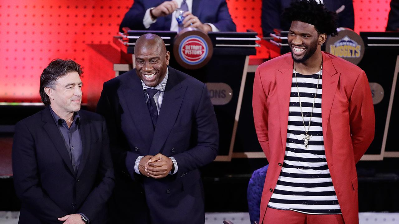Boston Celtics co-owner Wyc Grousbeck, left, Magic Johnson, president of basketball operations for the Los Angeles Lakers, center , and Philadelphia 76ers Joel Embiid, right.