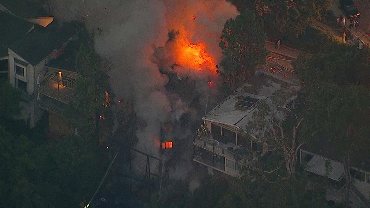 Massive fire rips through 4-story home in Pacific Palisades