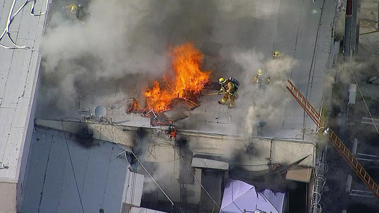 Firefighters from the Los Angeles City Fire Department battle a blaze at a building in the 5100 block of East York Boulevard on Wednesday, May 17, 2017.