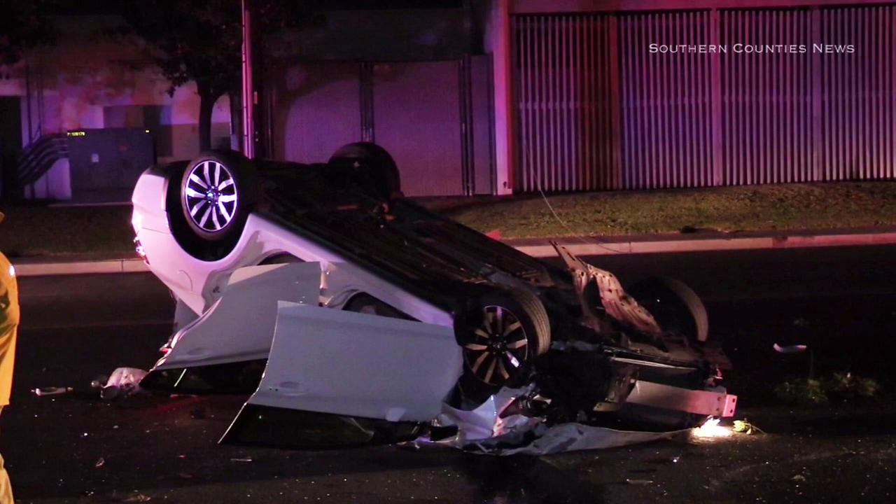 A car flipped over after the driver crashed trying to avoid a black cat near Norwalk on Monday, May 22, 2017.