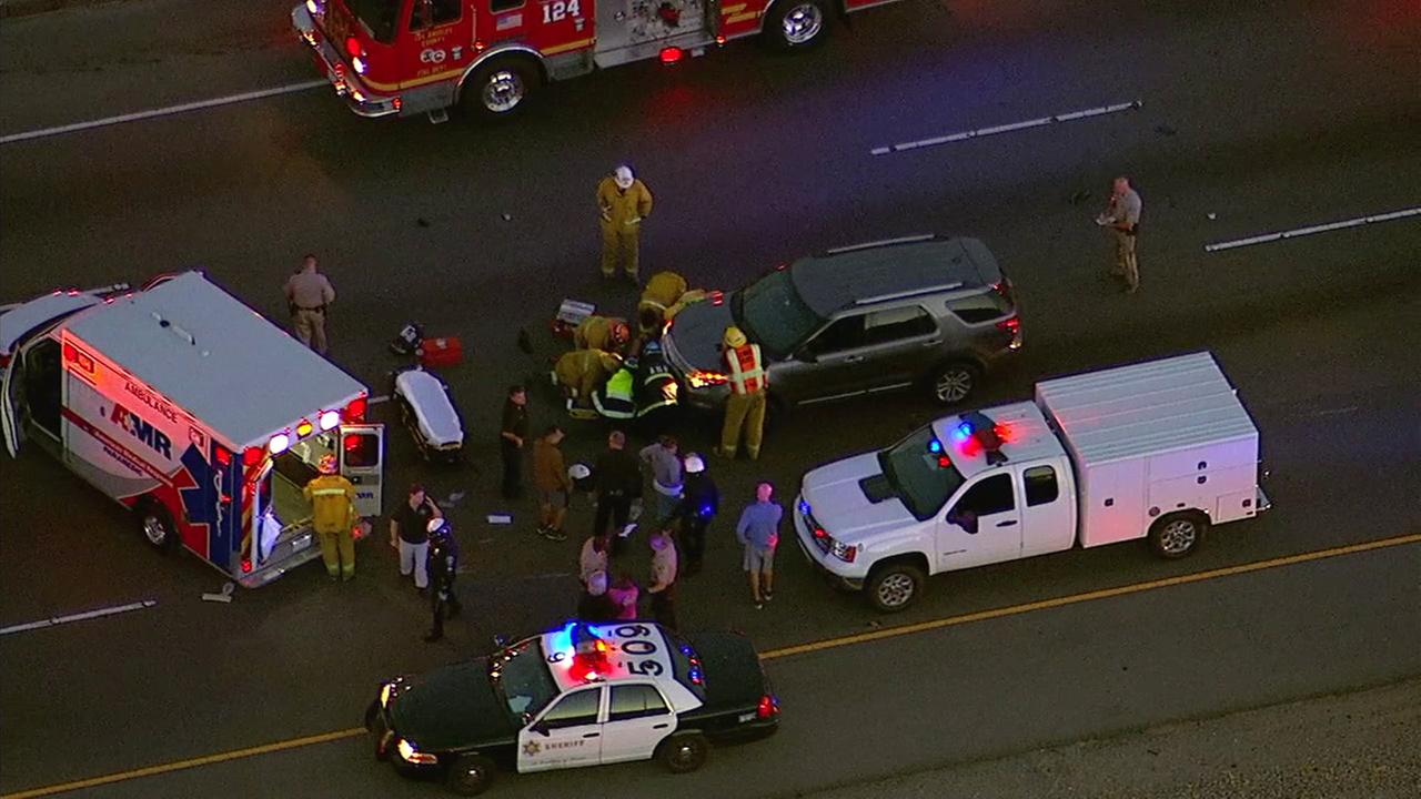 Crews rescue an officer pinned underneath an SUV after a crash on the southbound 5 Freeway in Valencia on Tuesday, May 23, 2017.