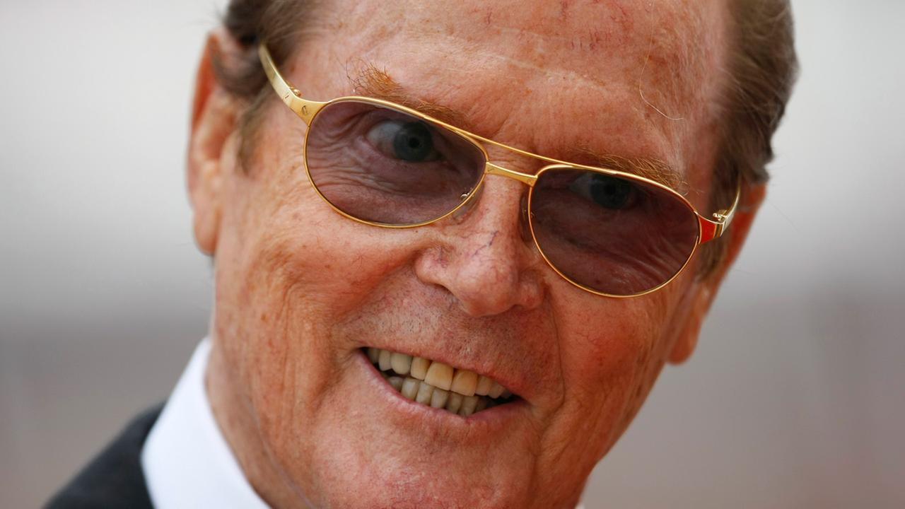 British actor Sir Roger Moore arrives at the Monaco palace for a religious wedding ceremony Saturday, July 2, 2011.