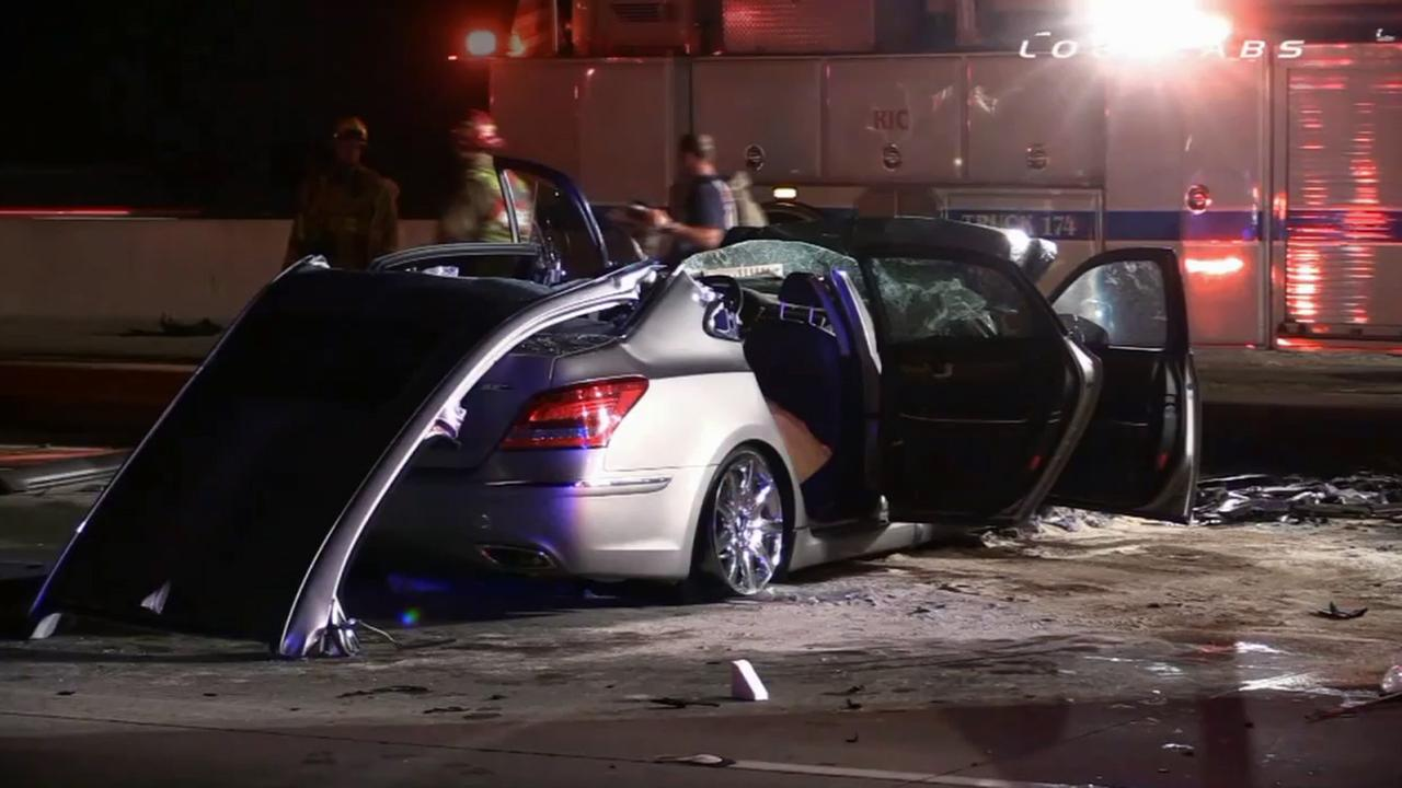 A car is crushed after a wrong-way driver collides head-on with another car on the eastbound 210 Freeway in Rancho Cucamonga on Sunday, July 20, 2014.