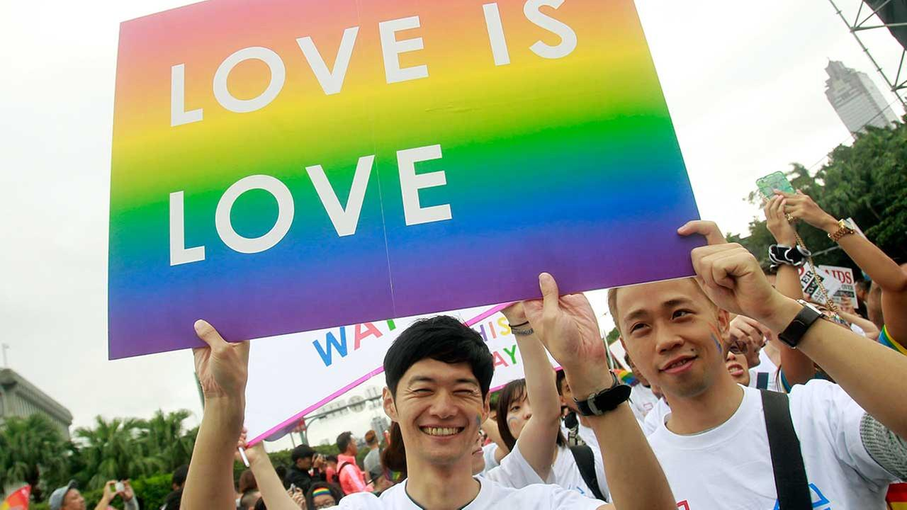 In this Saturday, Oct. 31, 2015, file photo, revelers participate in a gay pride parade in Taipei, Taiwan.
