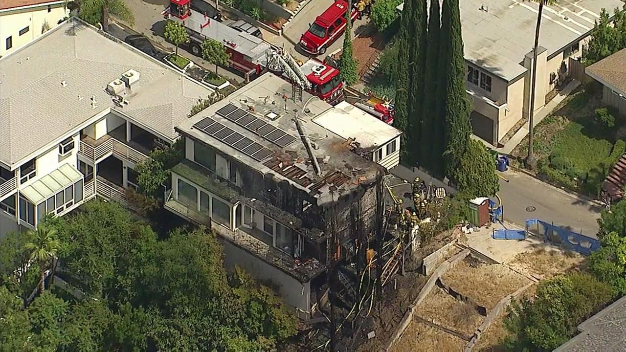 The burned remains of a three-story home in Sherman Oaks is shown in footage captured by AIR7 HD on Thursday, May 25, 2017.