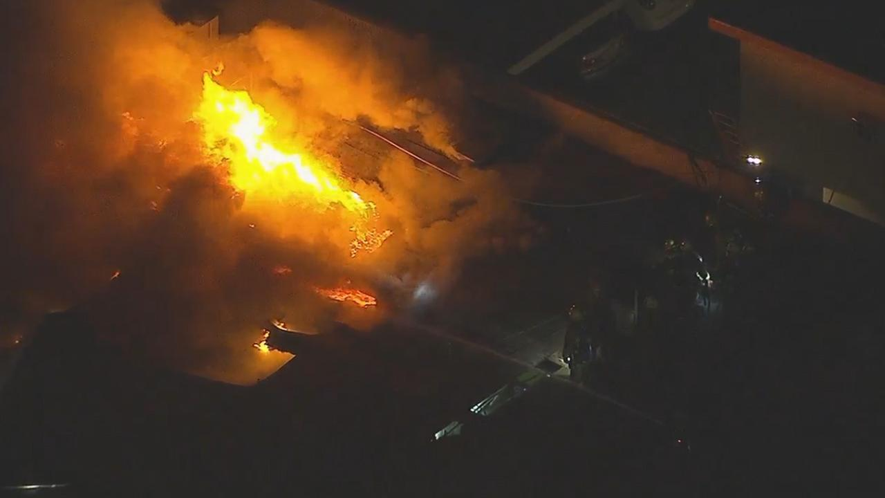 Large, explosive flames shoot up from a strip mall in Van Nuys on Thursday, May 25, 2017.