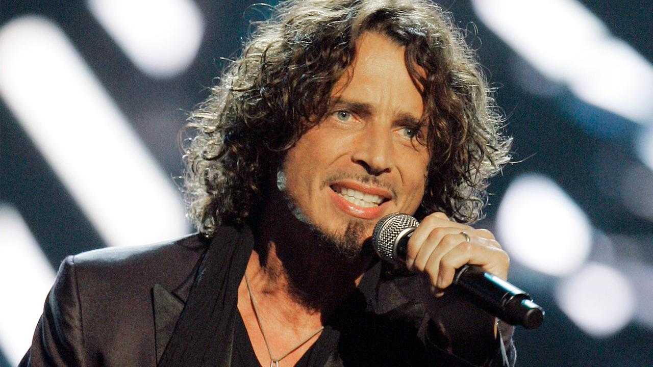In this Sept. 5, 2008, file photo, musician Chris Cornell performs on stage during Conde Nasts Fashion Rocks show in New York.