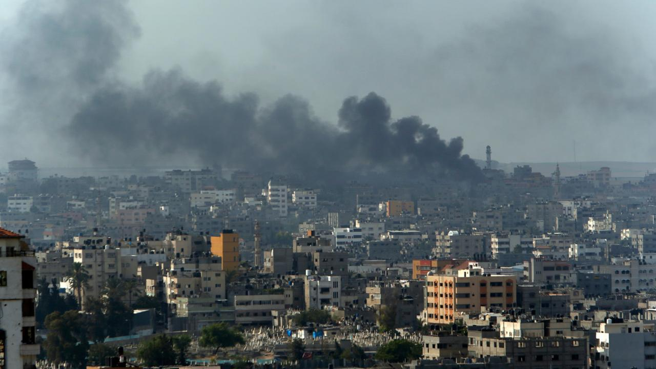 Smoke from Israeli strikes rise over Gaza City, northern Gaza Strip, Monday, July 21, 2014.