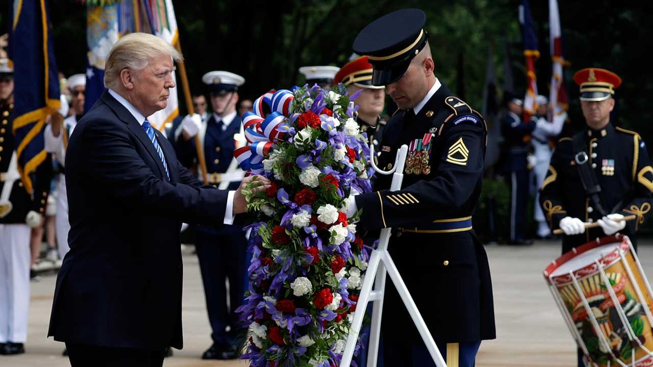 President Donald Trump participates in a wreath laying ceremony at Arlington National Cemetery, Monday, May 29, 2017, in Arlington, Va.