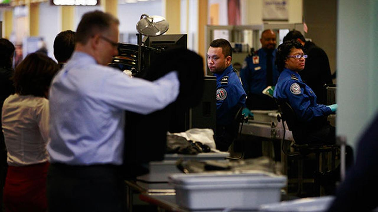 Transportation Security Adminstration (TSA) workers screen passengers at Washingtons Ronald Reagan National Airport.