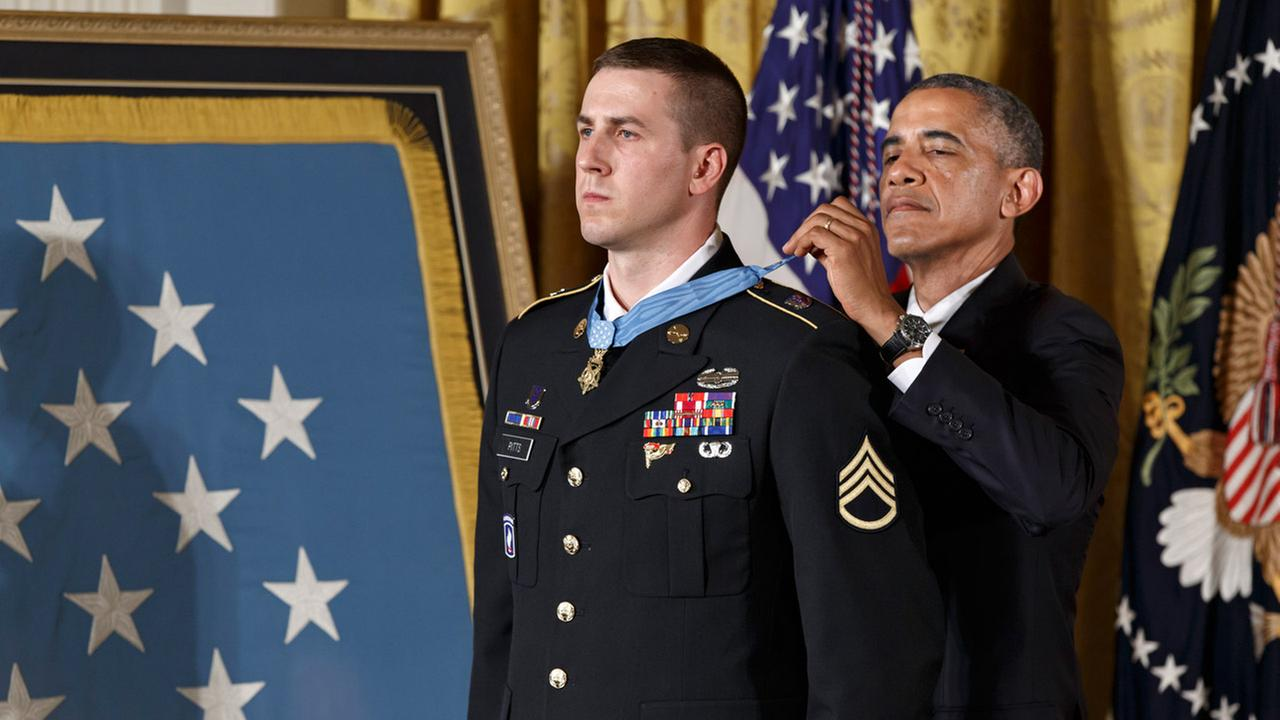 President Barack Obama bestows the Medal of Honor, the nations highest decoration for battlefield valor, to Ryan M. Pitts, 28, of Nashua, NH, in Washington, Monday, July 21, 2014.
